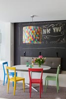 Colourful furniture in modern dining area