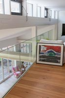 Colourful framed painting on modern upstairs landing
