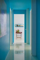 Bright turquoise painted corridor