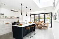 Modern black and white kitchen-diner