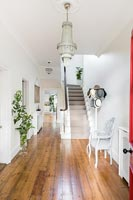 Large white painted entrance hall with wooden floorboards