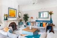 Modern living room with orange and blue accessories