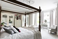 Black fourposter bed in white bedroom