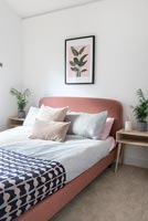Modern bedroom with pink headboard