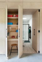 Desk area hidden within built-in wardrobe in modern childrens room