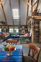 Open plan living area in barn for seating and dining