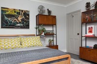 Yellow and grey bedding and vintage furniture in modern bedroom