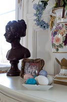 Bust and ornaments on sideboard