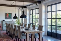 Large wooden table in modern industrial dining room