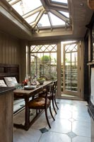 Country dining area with wood panelling