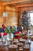 Modern country open plan living and dining space decorated for Christmas