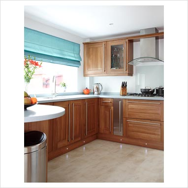 Gap interiors modern kitchen with dark wood units with for Kitchen units without plinths