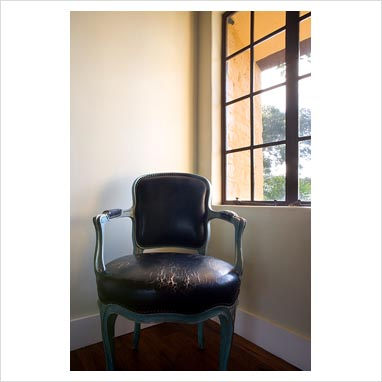 Gap interiors worn antique leather chair in corner next for Chair next to window