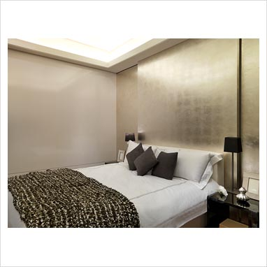 gap interiors modern bedroom with gold wall picture