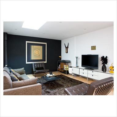 black feature wall living room gap interiors 23378