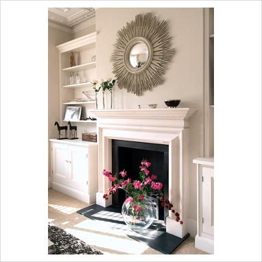 gap interiors sunburst mirror over classic fireplace